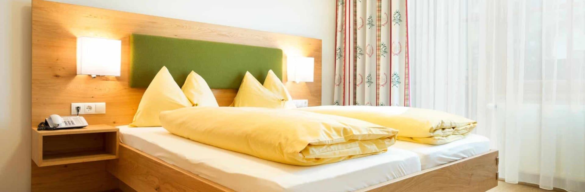 Hotel Matschner - Suite Steirerland Schlafzimmer